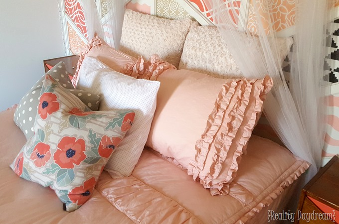 Cute bedding from Beddys for little girls room with canopy over bed {Reality Daydream}