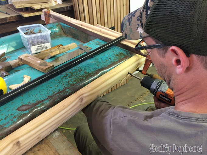 Attaching the tailgate to the frame to make a UNIQUE bench!