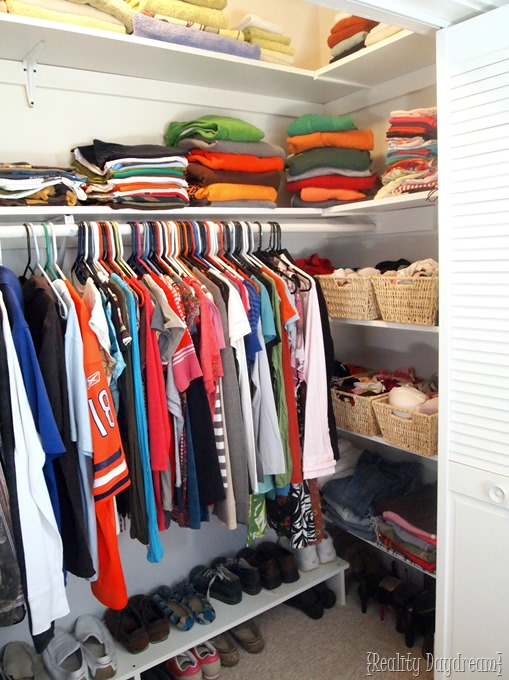Maximize space in your builder-basic closet by adding shelving on the sides... SO MUCH MORE storage and organization possibilities! {Reality Daydream}