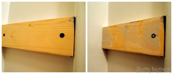 We applied drywall compound to the braces of our DIY custom shelving units.