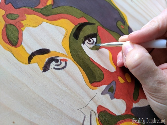 Make a unique piece of wall art by posterizing an image and painting it onto a wooden canvas with stain {Reality Daydream}