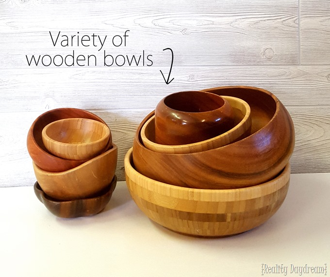 Use a variety of wooden bowls to make this vertical 'living wall' art installation planter! {Reality Daydream}