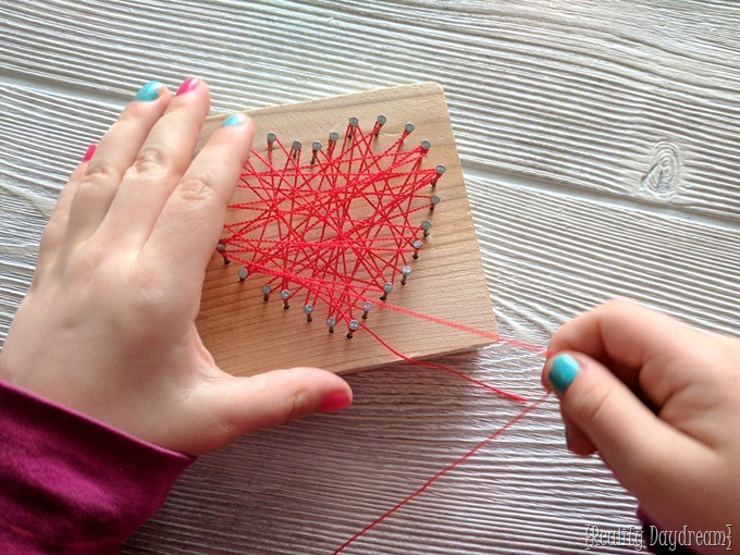 Heart shaped String Art Craft for Kids - perfect for Valentine's Day! {Reality Daydream}