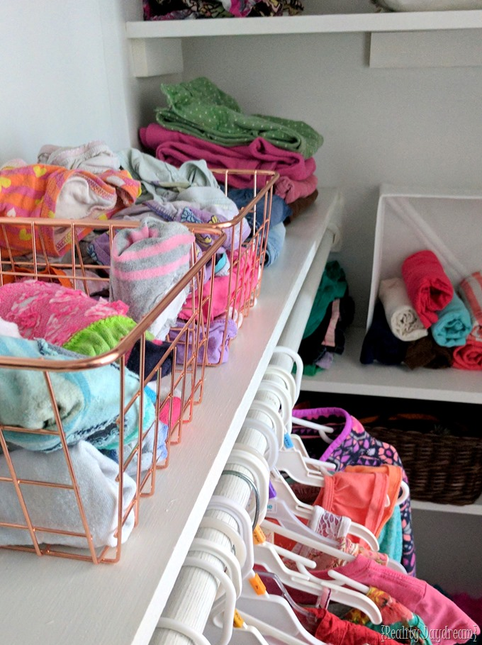 Add shelving to any builder grade closet to add storage and organization! {Reality Daydream}
