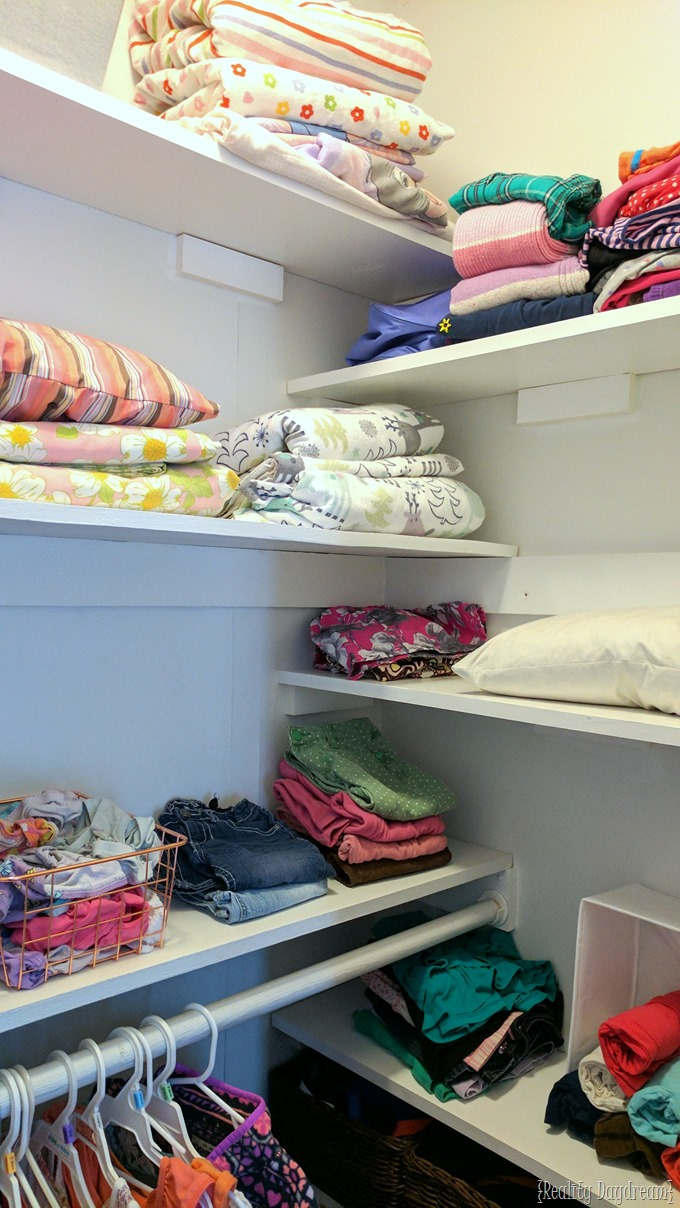 Adding shelves to any builder grade closet adds soooo many storage and organizational opportunities... especially in a kids closet! {Reality Daydream}