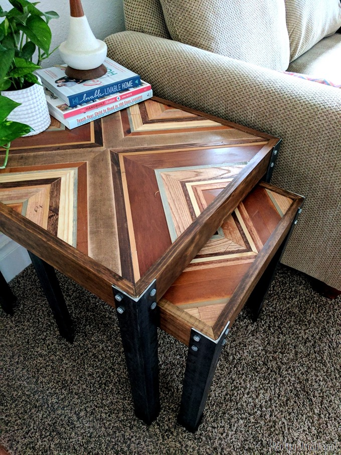 These nesting tables are made from scrap wood to make the decorative wooden inlay, and angle iron for the legs! {Reality Daydream}
