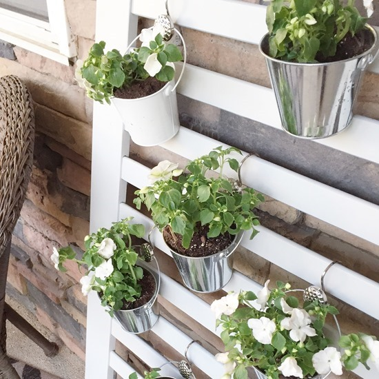 Repurposed baby crib into unique vertical planter - roundup of living wall ideas by Reality Daydream
