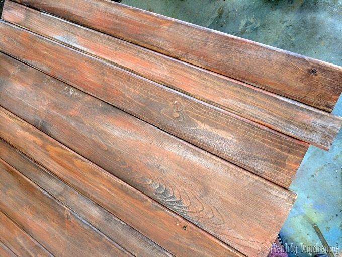 These were new pine boards 5 mins ago! Learn how to make new wood look like old barnboards with this technique {Reality Daydream}