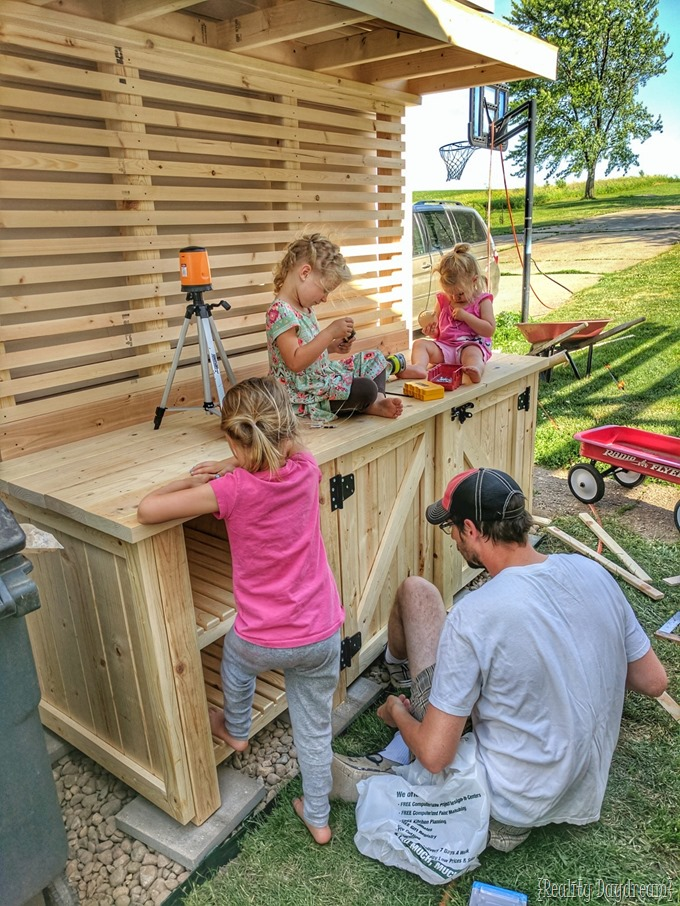 Family project... potting bench with garbage can enclosure {Reality Daydream}
