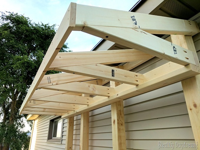 Making the roof or 'awning' for this potting bench garbage can enclosure {Reality Daydream}