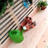 Potting Bench with Hidden Garbage Can Enclosure