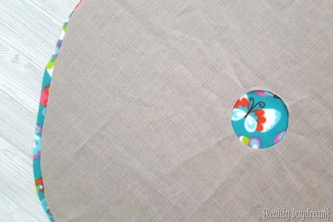 Use the linen fabric as a guide to replicate the head hole in the fleece fabric.
