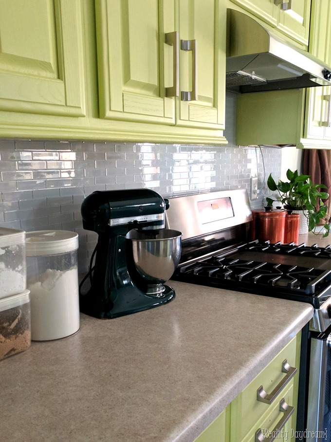 Chartreuse cabinets and installing a backsplash with white glass subway tile installation {Reality Daydream} #kitchen