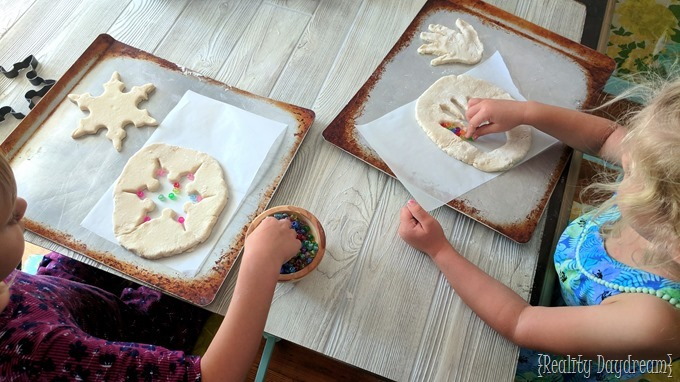 Making handprint (or cookie cutter) suncatchers with salt dough! {Reality Daydream}