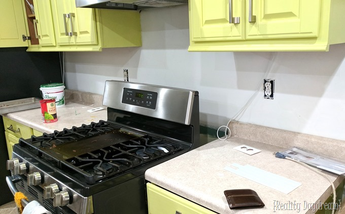 Preparing the backsplash to install glass subway tiles from Aspect {Reality Daydream}