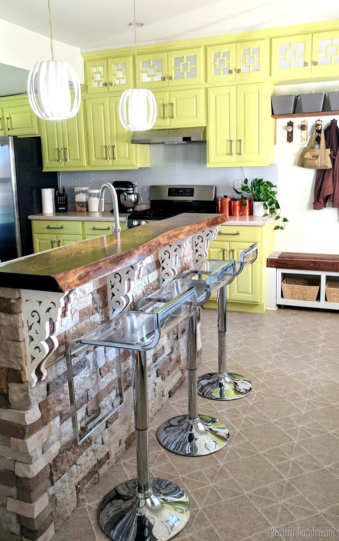 Reality Daydream Kitchen... yellow cabinets, white glass subway tile, live-edge breakfast bar {Reality Daydream}