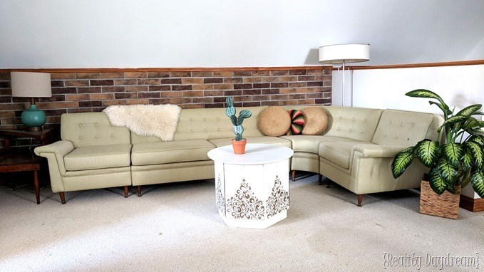 Add a brick accent wall with Coronado brick veneer below the chair rail {Reality Daydream}