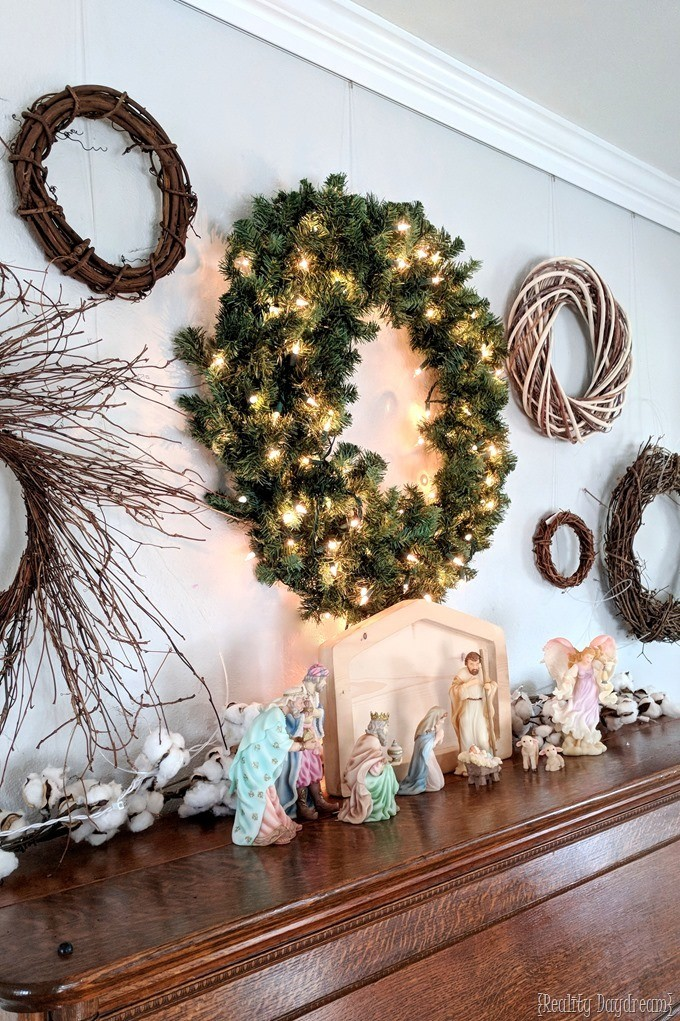 Holiday Gallery Wall and piano styled for Christmas with wreaths and nativity {Reality Daydream}