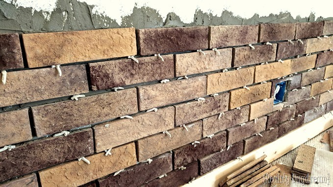 Laying thin brick veneer as an accent wall in family room {Reality Daydream}