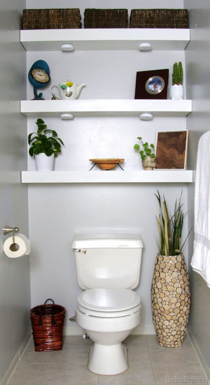 Floating Shelving in the bathroom behind toilet