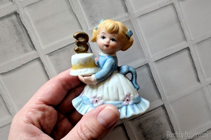 Glass figurine of a little girl with a number 3 - perfect for making a snow globe! {Reality Daydream}