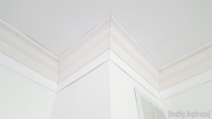 Super chunky crown molding installation using layered trim pieces {Reality Daydream}