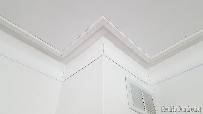 Use 3 different types of trim to make super chunky crown molding along the ceiling! {Reality Daydream}