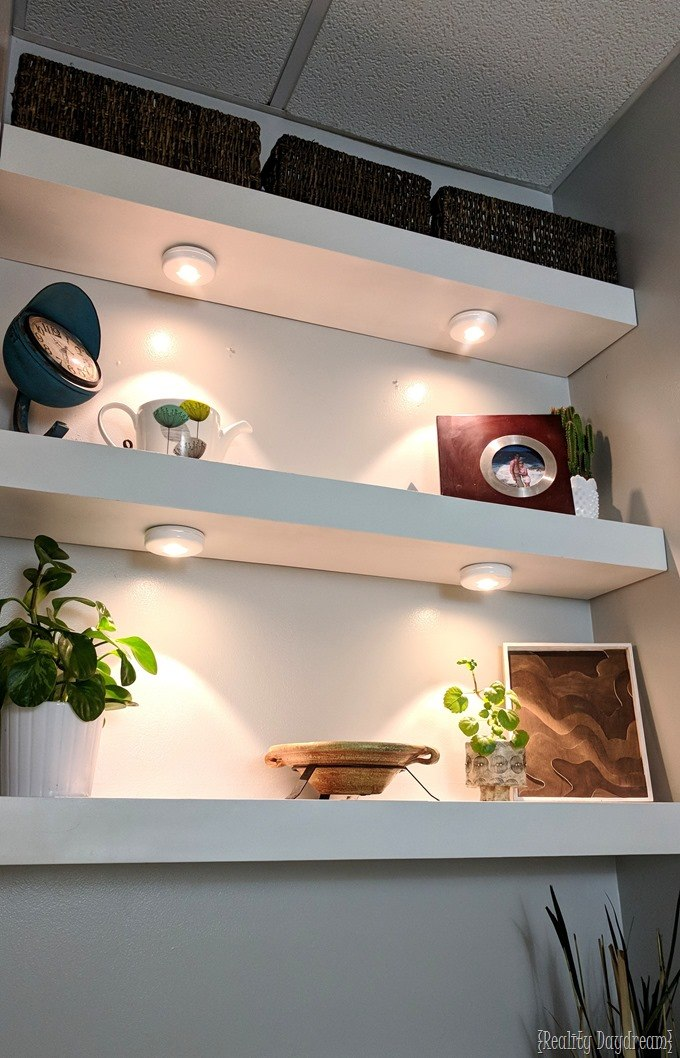 Using puck lights under DIY floating shelves in bathroom