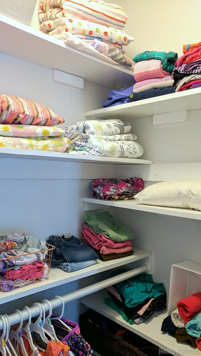Add tons of shelves to tiny closets to maximize space and organization. Perfect for kids closets! {Reality Daydream}