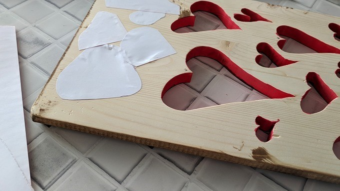Heart-shaped plaque with pictures and valentine's scrapbook paper {Reality Daydream}