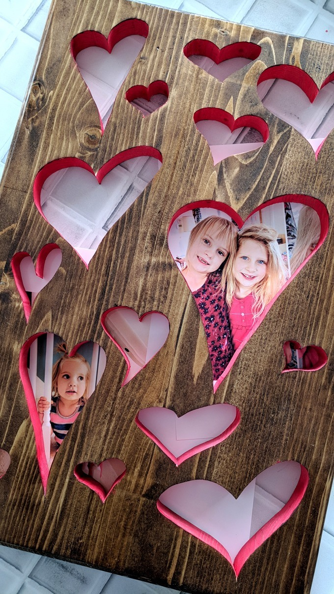 Plaque with heart-shaped cutouts for Valentine's Day using a scroll saw {Reality Daydream}