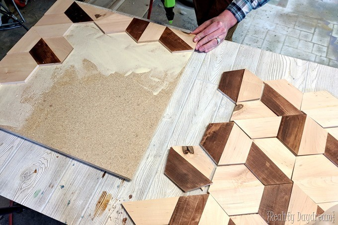 Gluing together this 3D Wall Art made from wood and mirror! {Reality Daydream}