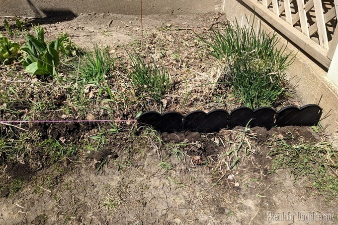 Installing landscape edging and mulching your flower garden {Reality Daydream}