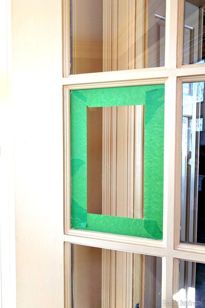 Taping off window panes to paint french doors {Reality Daydream}