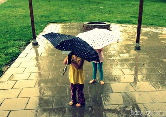 Twins playing in the rain {Reality Daydream}