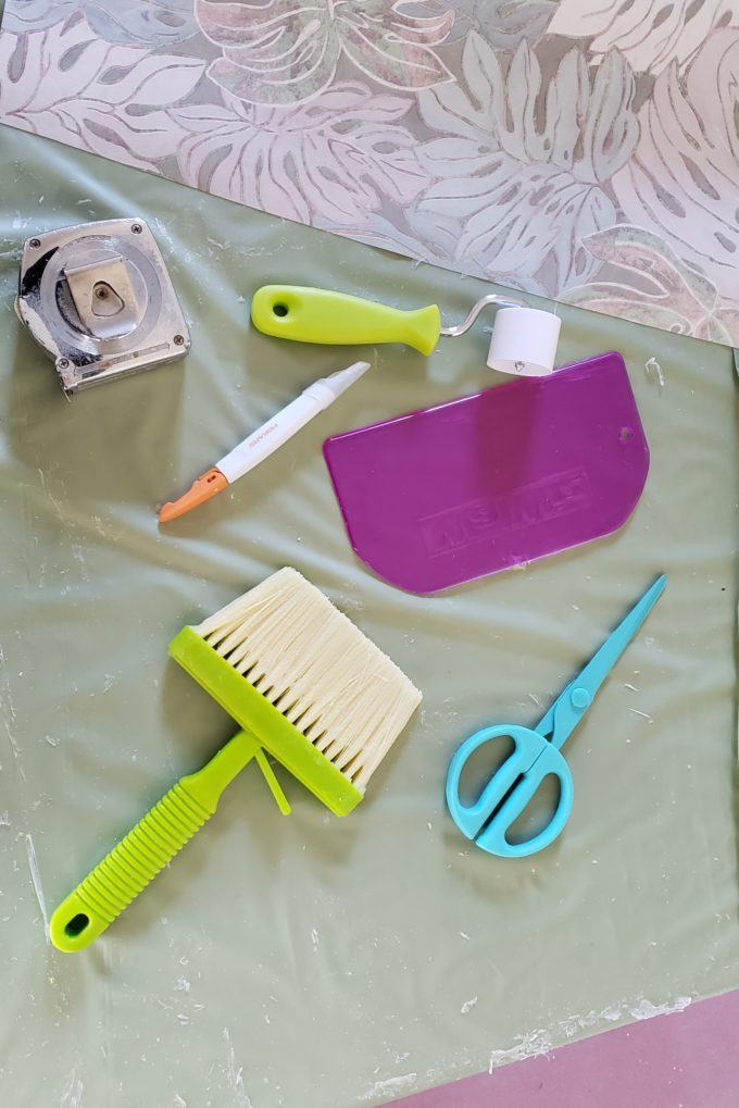 Tools and supplies for putting up wallpaper with wallpaper paste